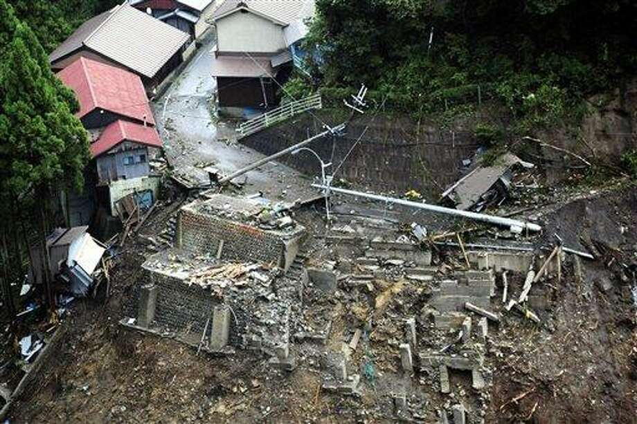 Houses are washed away as heavy downpours by Typhoon Talas caused a landslide in Gojo, central Japan, Sunday, Sept. 4, 2011. The center of the season's 12th typhoon was moving slowly north across the Sea of Japan, the Japan Meteorological Agency said. (AP Photo/Kyodo News) JAPAN OUT, MANDATORY CREDIT, NO LICENSING IN CHINA, FRANCE, HONG KONG, JAPAN AND SOUTH KOREA Photo: AP / Kyodo News