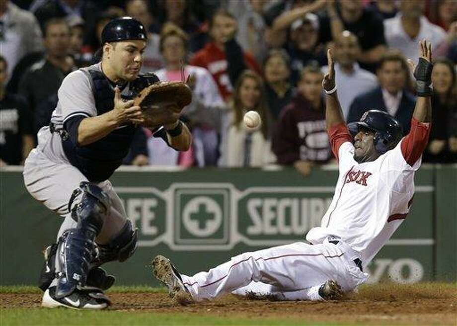 Boston Red Sox's Pedro Ciriaco slides in to score the winning run on a single hit by Jacoby Ellsbury as New York Yankees catcher Russell Martin, left, waits for the late throw during the ninth inning of a baseball game at Fenway Park in Boston, Tuesday, Sept. 11, 2012. The Red Sox won 4-3. (AP Photo/Elise Amendola) Photo: ASSOCIATED PRESS / AP2012