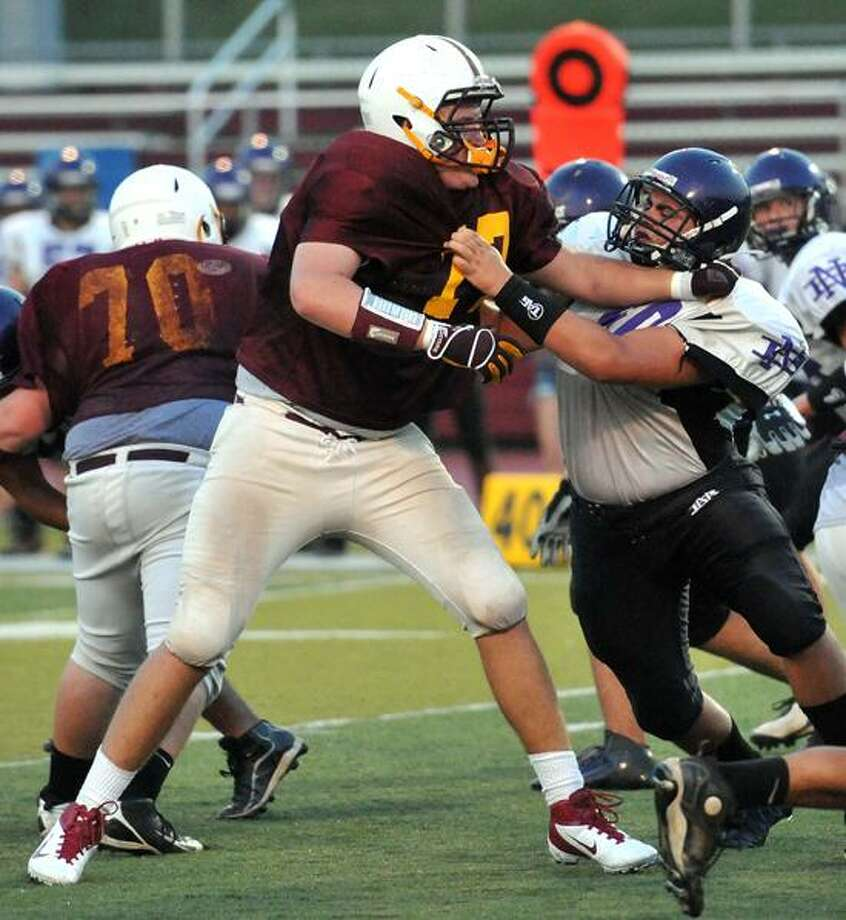 Wallingford-- Sheehan defensive lineman Sean Merrill during the scrimmage against North Branford Friday night. Photo (right) Peter Casolino/New Haven Register 09/08/2012