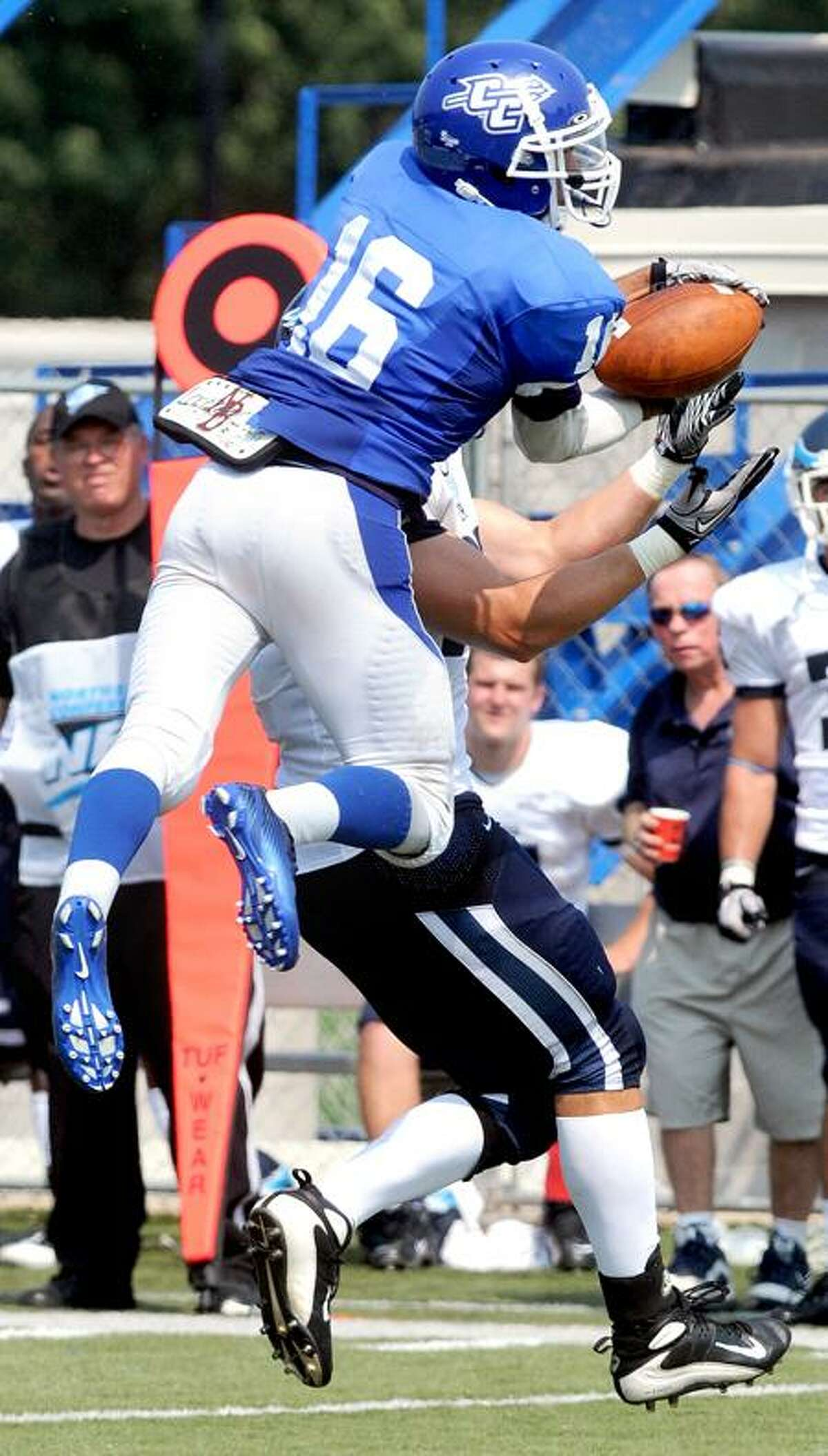Chris Linares (top) of CCSU breaks up a pass intended for Curtis Shappy (bottom) in the second half in New Britain on 9/3/2011. Photo by Arnold Gold/New Haven Register AG0423B