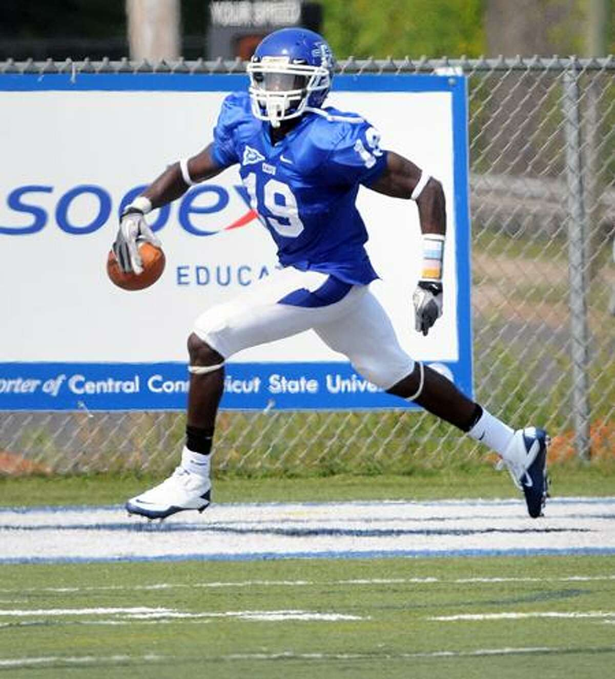 Matthew Tyrell of CCSU ran an on-side kick for a touchdown in the fourth quarter against SCSU in New Britain on 9/3/2011.Photo by Arnold Gold/New Haven Register AG0423B