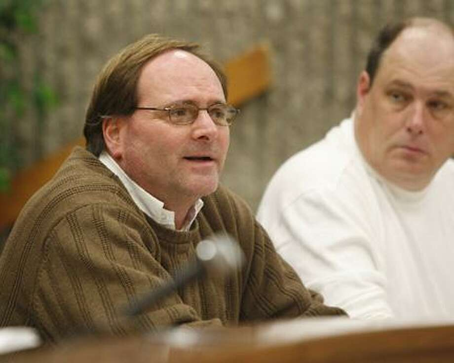 Dispatch Staff Photo by JOHN HAEGERWard 2 Councilman David Cimpi asks Chief of Police David Meeker why parking tickets are down and about his overtime budget as Ward 1 Councilman Dan Jones looks on during the city of Oneida Common Council meeting on Tuesday, Jan. 18, 2011.