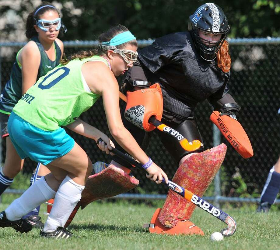 Milford-- Lauralton Hall Goalie Caitlin Bennett and defense Lindsey Spitz stop the ball during a practice Thursday.  Peter Casolino/New Haven Register 8/30/12