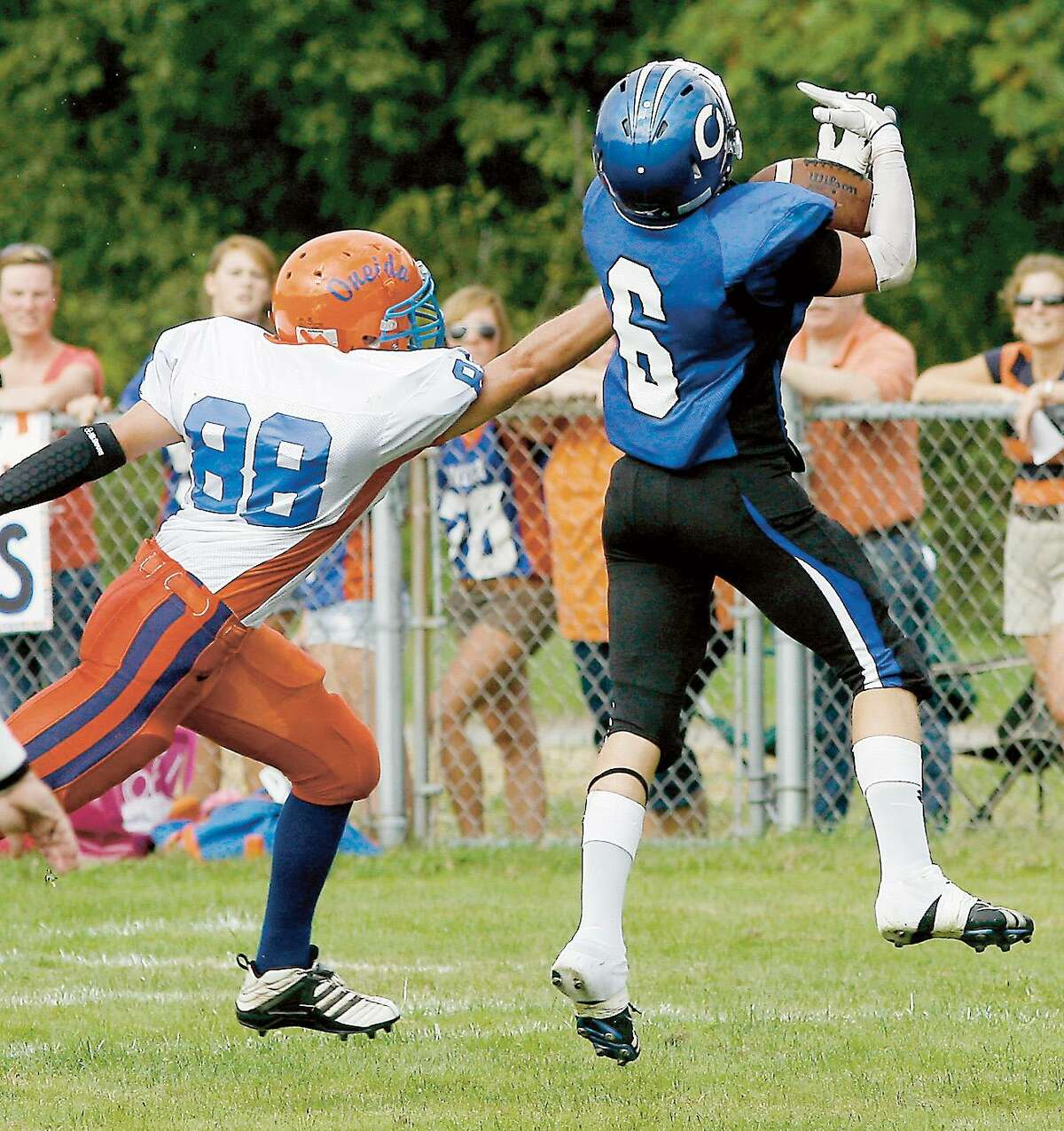 Dispatch Staff Photo by JOHN HAEGER twitter.com/oneidaphotoCamden's Cody Sullivan (6) leaps to make the catch as Oneida's Jimmy Moyer (88) defends in the first quarter of the season opener against Oneida on Friday, Sept. 2, 2011 in Camden.