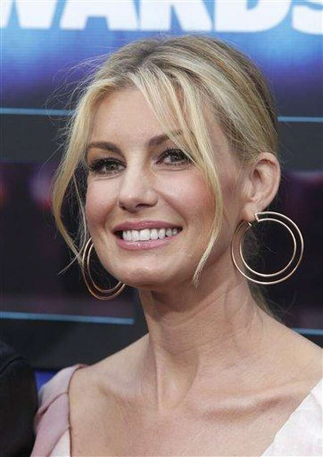 "FILE -- In a June 9, 2010 file photo country singer Faith Hill attends the 2010 CMT Music Awards, in Nashville, Tenn.  The Pretenders and Faith Hill are teaming up for live episode of ""CMT Crossroads"" on Feb. 5, 2011.  (AP Photo/Peter Kramer/file) Photo: AP / AP2010"