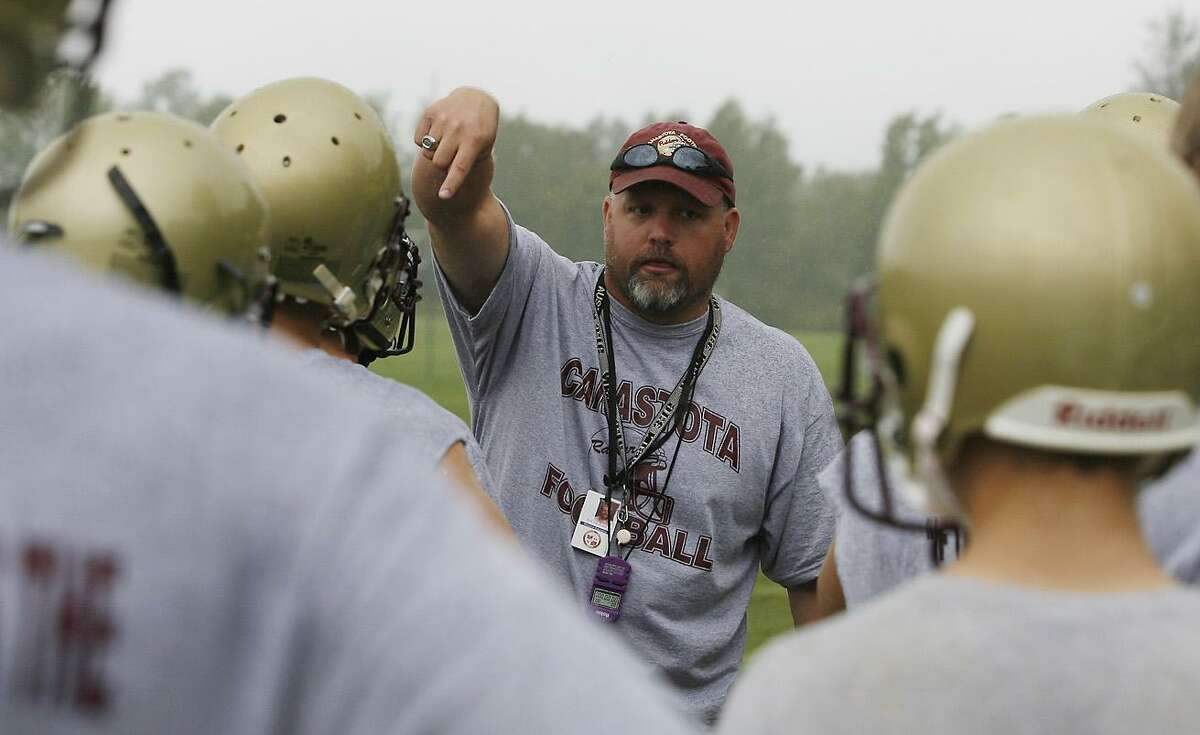 Dispatch Staff Photo by JOHN HAEGERtwitter.com/oneidaphotoCanastota headcoach Eric VanSlyke (SP?) goes over a drill with players on the opening day of the 2011 season on Monday, Aug. 15, 2011.