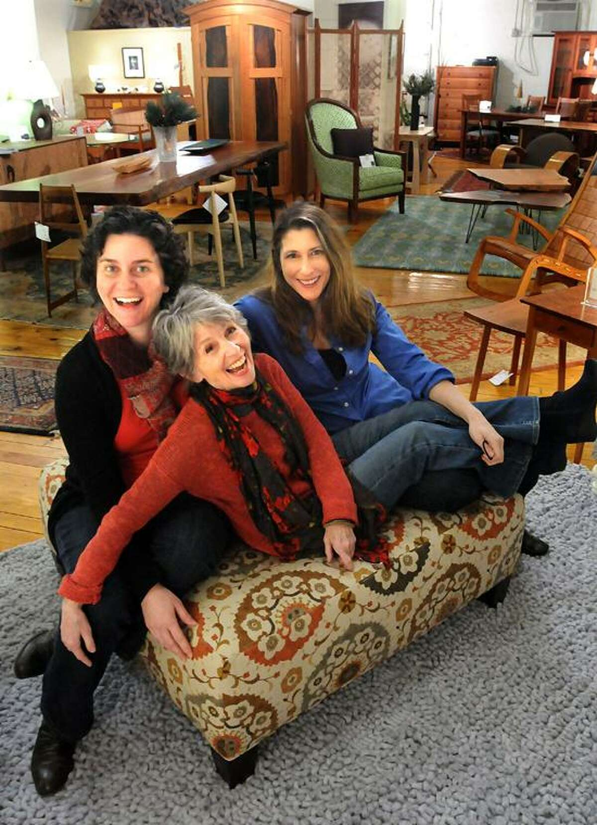 Mara Lavitt/Register: Founding members of Theatre 4, Mariah Sage of New Haven, left, Jane Tamarkin of Woodbridge and Rebecka Jones of Hamden, lounge about at Fairhaven Furniture, the site of their next production.