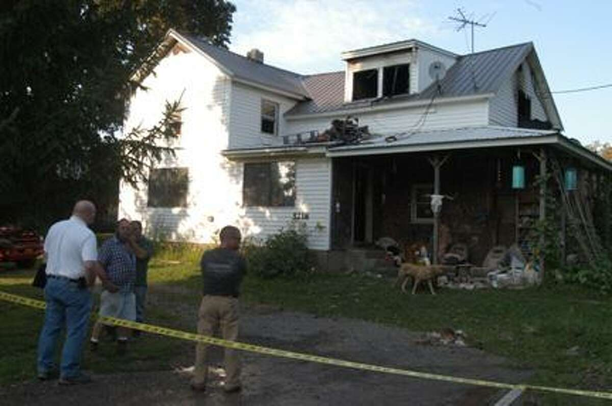 Dispatch Staff Photo by KURT WANFRIED People and pets escaped injury in Thursday afternoon's fire in Peterboro.