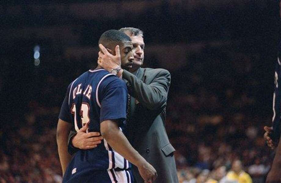 Connecticut head coach Jim Calhoun hugs Kevin Ollie with one minute left on the clock during the NCAA West Regional Championship against UCLA on Saturday, March 25, 1995 at the Oakland Coliseum in Oakland, Calif. Connecticut was eliminated by UCLA 102-96. (AP Photo/Susan Ragan) Photo: AP / 1995 AP