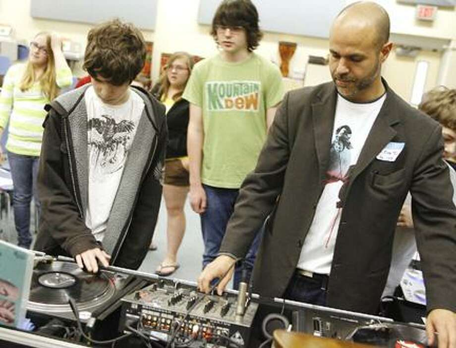 Dispatch Staff Photo by JOHN HAEGEROtto Shortell Middle School seventh-grader Tyler Coapman, 12, checks out DJ Marc Tucci's turntable during a career fair held at the school on Tuesday, May 17, 2011.