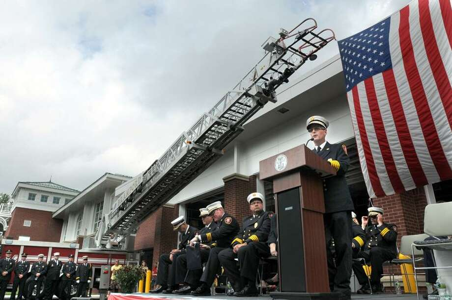 Branford fire chief Jack Ahern spoke at the official opening of Branford's new fire house on North Main St.  Mara Lavitt/New Haven Register9/8/12