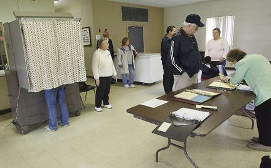 Photo by JOHN HAEGER Voters cast their ballots during the Vernon-Verona-Sherrill school budget vote on Tuesday, May 18, 2011 at the Verona Fire Hall.