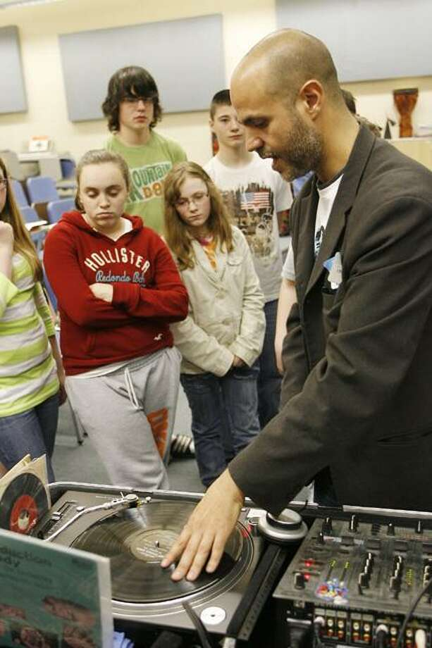 Photo by JOHN HAEGER Otto Shortell Middle School seventh-graders watch DJ Marc Tucci talk about his career and tools of his trade during a career fair held at the school on Tuesday, May 17, 2011.
