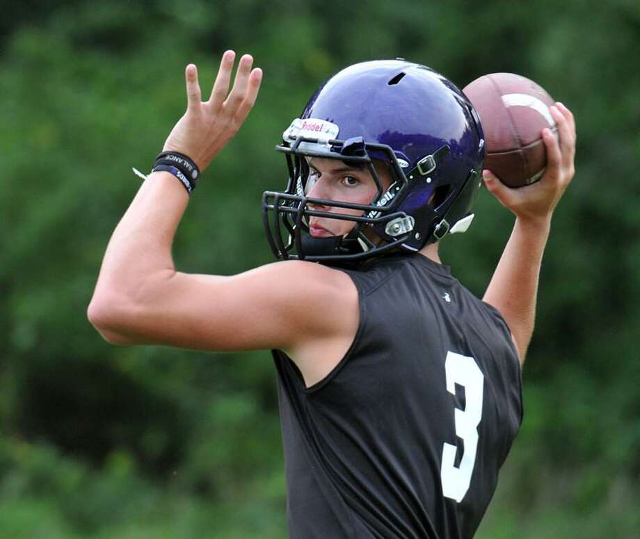 North Branford quarterback Brandan Basil hopes to lead the Thunderbirds to the Pequot Conference title this season. Peter Casolino/New Haven Register.