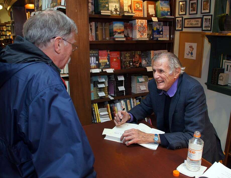 """Madison-- Frank DeFord signs his book """"Over Time: My Life as a Sportswriter,"""" for John Kozob at R.J. Julia Booksellers. Kozob is from Guilford. Peter Casolino/New Haven Register 05/15/12"""