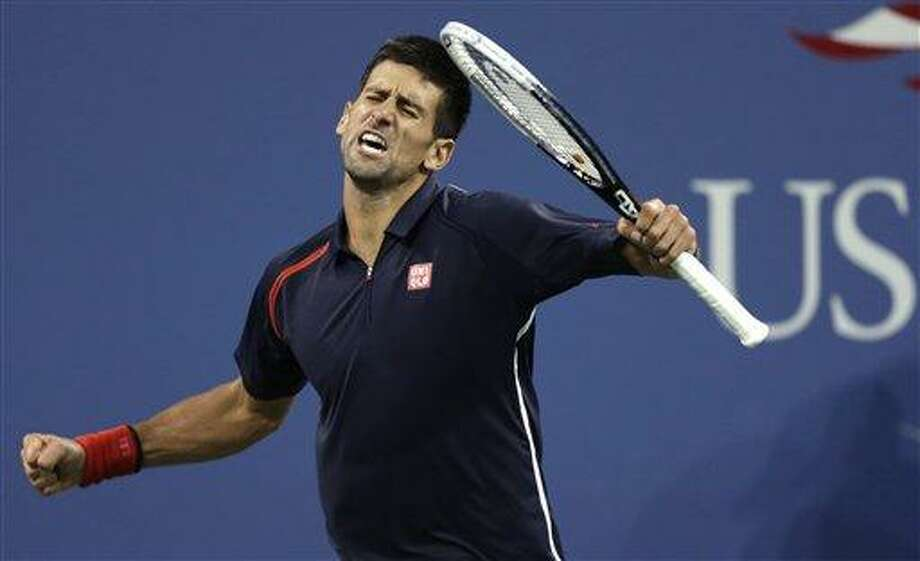 Novak Djokovic, of Serbia, reacts after winning a point against Juan Martin del Potro, of Argentina, during a quarterfinal of the U.S. Open tennis tournament, Thursday, Sept. 6, 2012, in New York. (AP Photo/Charles Krupa) Photo: AP / AP