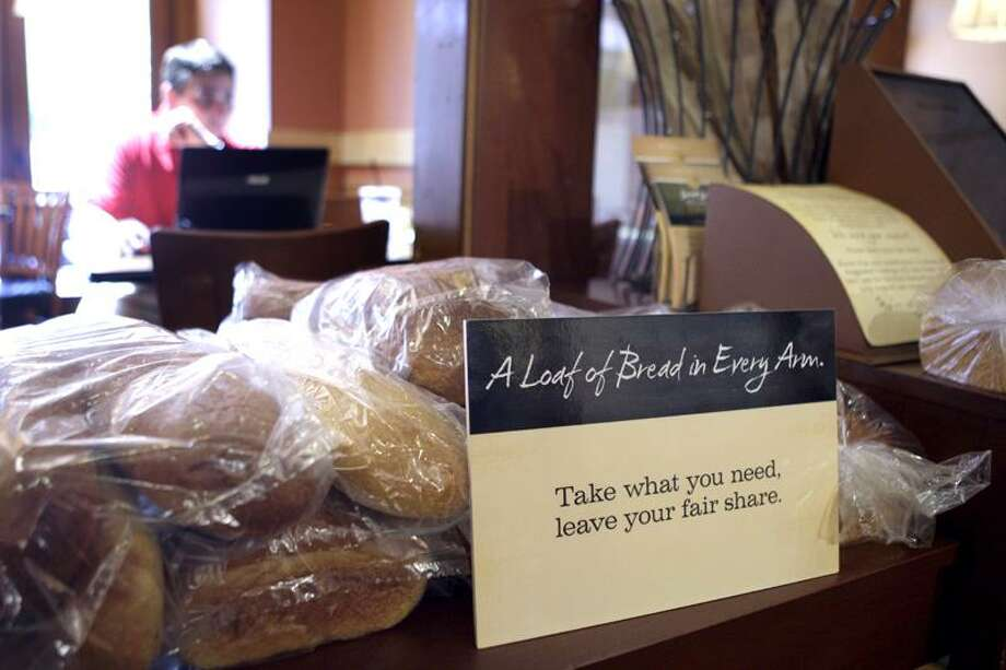 "Loaves of bread sit on a table at a Panera Bread Co. restaurant in Clayton, Mo. The ""pay-as-you-go"" cafe in Clayton, which opened May 16, 2010, is doing so well, that Panera has since opened similar restaurants in suburban Detroit and in Portland, Ore. (Associated Press) Photo: AP / AP2010"