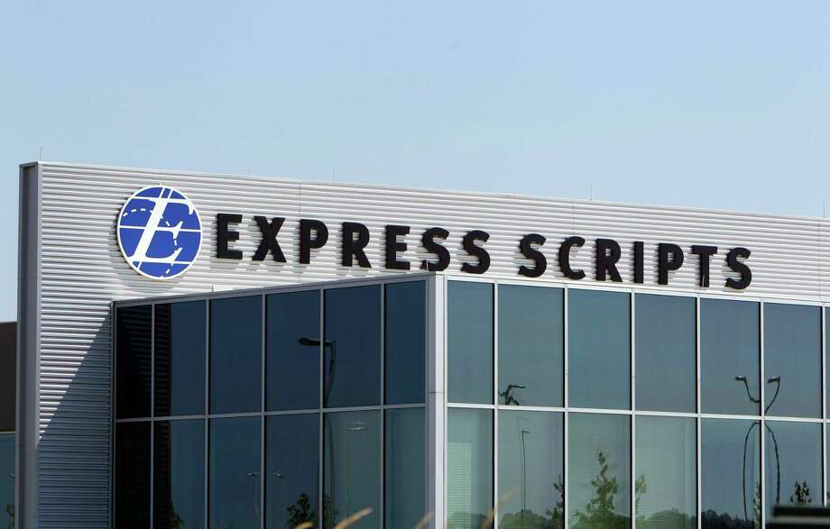 FILE - This July 21, 2011, file photo shows a building on the Express Scripts campus in Berkeley, Mo. Express Scripts, the nation's largest pharmacy benefits manager, will limit the number and strength of opioid drugs prescribed to first-time users starting in September 2017 as part of a wide-ranging effort to curb an epidemic affecting millions of Americans. The new program is drawing criticism from the American Medical Association. (AP Photo/Jeff Roberson, File) ORG XMIT: CER802 Photo: Jeff Roberson / Copyright 2017 The Associated Press. All rights reserved.