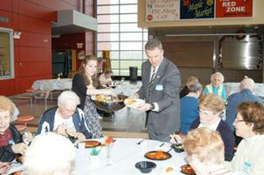 Photo by MATT POWERS Jacquelynn Frank, 17, and VVS High School principal Andy Brown serve seniors at the annual Appreciation Dinner Monday at the Sheveron Center at VVS High School.