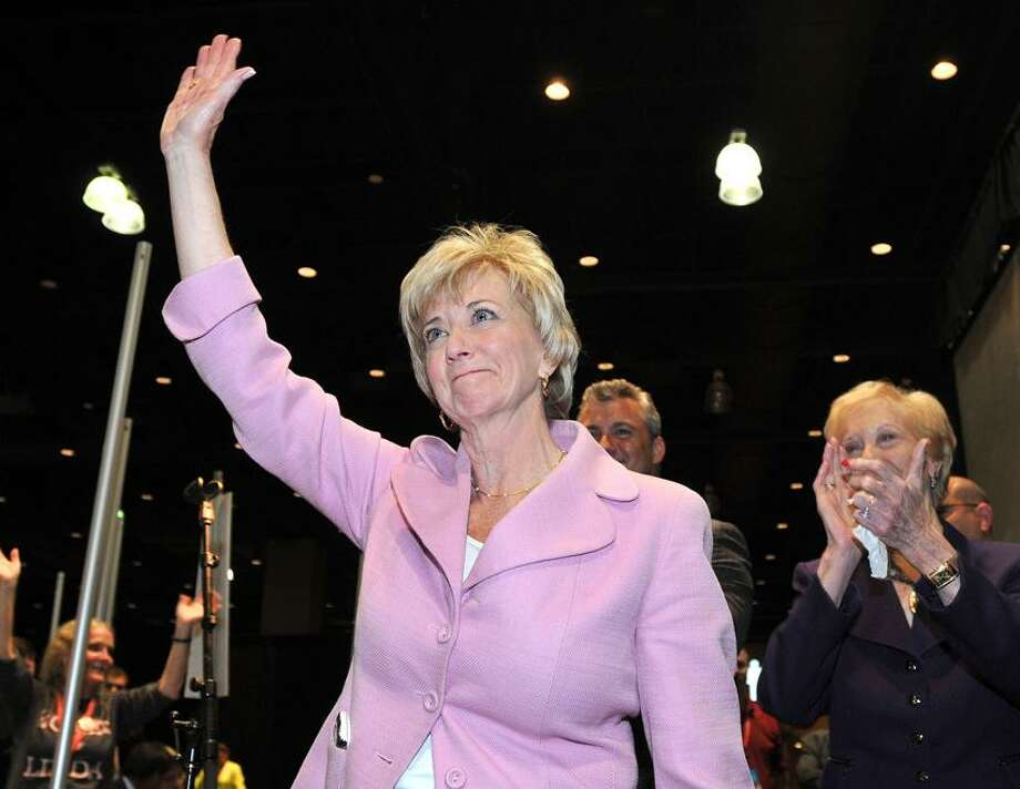 Hartford--Linda McMahon waves to the crowd after winner the GOP nomination at the Republican convention in Hartford. Peter Casolino/New Haven Register 05/18/12