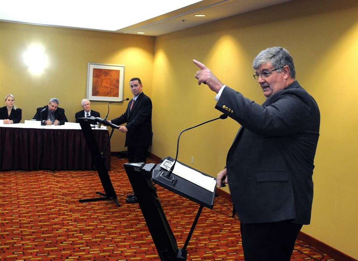Orange-- Incumbent First Selectman Jim Zeoli debates with contender Kevin McNabola at the Courtyard Marriott in Orange. Peter Casolino/Register