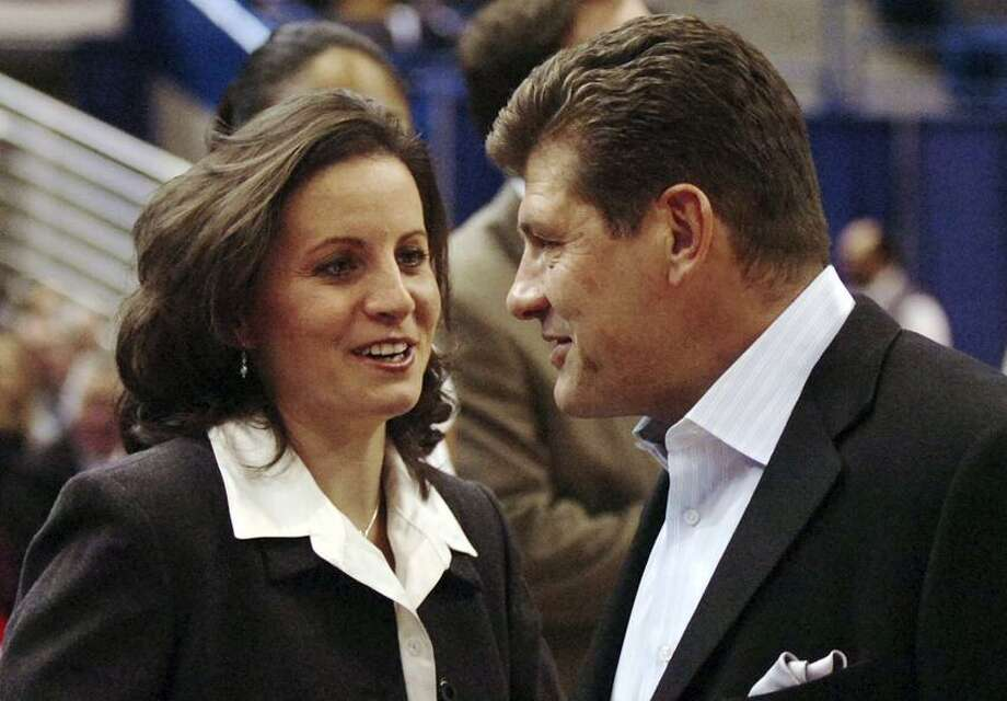 After a two-year hiatus UConn coach Geno Auriemma will match wits with former UConn point guard Jen Rizzotti and her Hartford Hawks on Dec. 22. (AP File Photo/Fred Beckham) Photo: ASSOCIATED PRESS / AP2007