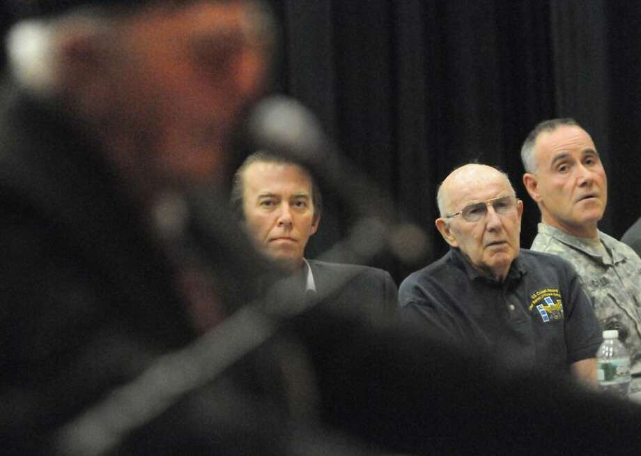 """Left to right: Listen to World War II veteran Domenic Falcone speak, left, are World Trade Center survivor Don Bender of West Orange, N.J. ;  retired U.S. Coast Guardsman Lt. Commander Melvin Gouthro of Wrentham, Mass.; and U.S. Army First Sgt. Dave Carello of Bristol, Conn.  before they speak to North Haven High School students Friday 5/18/12 about their first person accounts of U.S. wars, conflicts and events that shaped history from World War II to the Operation Iraqi Freedom and Operation Enduring Freedom in iraq and Afghanistan during a North Haven High School program """"An Eyewitness to History"""" .sponsored by  the schools 11th grade U.S. History class.Photo by Peter Hvizdak/ New Haven Register Photo: New Haven Register / ©Peter Hvizdak /  New Haven Register"""