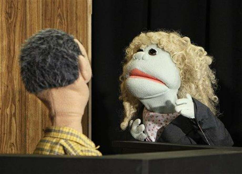 A puppet representing defense attorney Andrea Whitaker cross-examines a Ferris Kleem puppet during taping at WOIO-TV in Cleveland Thursday, Jan. 19, 2012. The station uses the puppets performing as witnesses, reporters and jurors to detail the corruption trial against former Cuyahoga county commissioner Jimmy Dimora, which began last week in federal court in Akron. (AP Photo/Mark Duncan) Photo: AP / HFR
