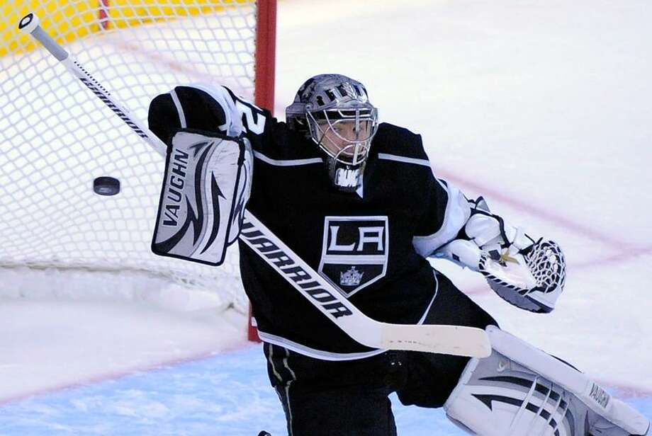 Los Angeles Kings goalie Jonathan Quick stops a shot during the second period of Game 3 of the NHL hockey Stanley Cup Western Conference finals against the Phoenix Coyotes, Thursday, May 17, 2012, in Los Angeles.  (AP Photo/Mark J. Terrill) Photo: AP / AP2012