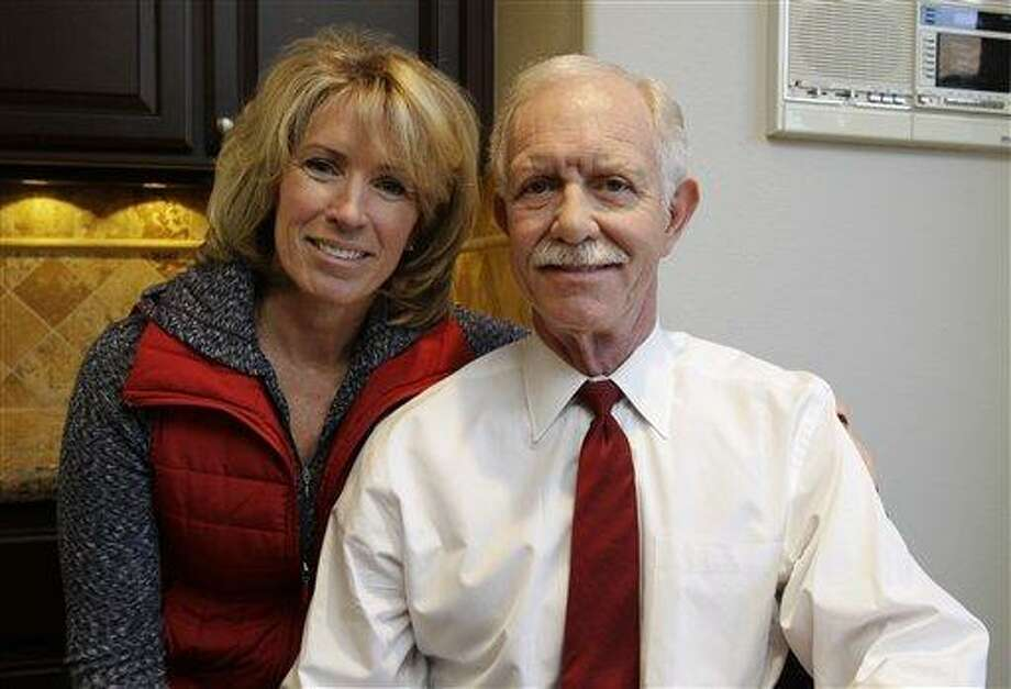"Capt. Chesley ""Sully"" Sullenberger and his wife, Lori, pose at their home in Danville, Calif., Monday, Jan. 10, 2011 before the second anniversary of US Airways flight #5149 landing. Sullenberger safely guided a stricken US Airways jet onto the Hudson River on Jan. 15, 2009. (AP Photo/Paul Sakuma) Photo: AP / AP"
