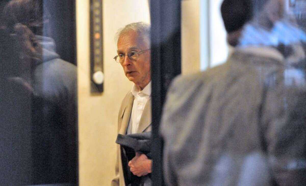 Benedict Komisarjevsky, 63, right, in New Haven Superior Court before the start of Thursday's proceedings in the second phase of his son's trial in the Cheshire triple-homicide case.The jury now must decide whether Joshua Komisarjevsky should spend the rest of his life in prison or be executed for his role in the strangling of Jennifer Hawke-Petit and the smoke inhalation deaths of her daughters, Michaela, 11, and Hayley, 17. The girls died after being tied to their beds. Komisarjevsky, 31, was convicted Oct. 13 on 17 counts in the crime, done in partnership with Steven Hayes, 48. Hayes was convicted last year and is on death row. Photo by Peter Hvizdak / New Haven RegisterOctober 27, 2011 ph2394 Connecticut