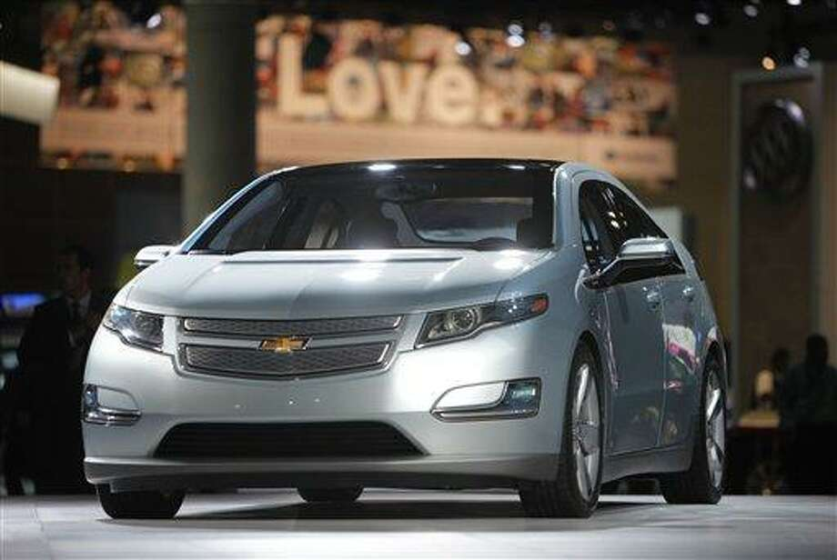 FILE - In this file photograph taken Dec. 2, 2009, the 2011 Chevrolet Volt debuts at the Los Angeles Auto Show, in Los Angeles. General Motors will strengthen the structure around the batteries in its Volt electric cars to keep them safe during crashes, a person briefed on the matter said Thursday. Jan. 5, 2011. (AP Photo/Jae C. Hong, File) Photo: AP / AP2009