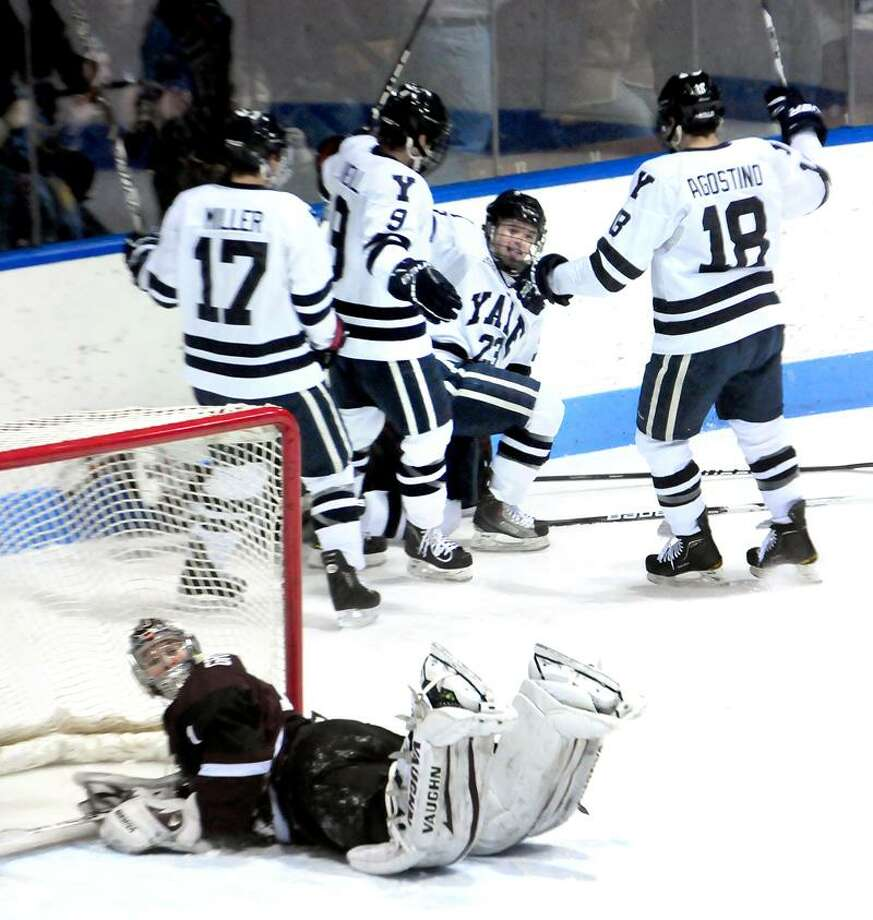 Yale celebrates a goal in the first period against Union on 1/20/2012.Photo by Arnold Gold/New Haven Register   AG0436A