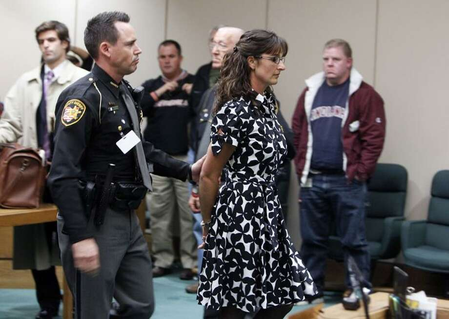 Stacy Schuler, a former health and physical education teacher at Mason High School in Ohio, is led out of the Warren County Common Pleas Courtroom of Judge Robert Peeler Thursday in Lebanon, Ohio. Schuler, a high school teacher was convicted Thursday of having sex with five of her students, some of them football players, after an Ohio judge rejected an insanity defense.  Associated Press Photo: AP / Cincinnati Enquirer