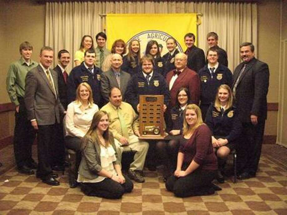 SUBMITTED PHOTO The Vernon-Verona-Sherrill Central School FFA chapter recently received the New York State Agricultural Society's FFA Chapter of the Year Award at its 179th annual Agricultural Forum on Jan. 6 in Syracuse. Kneeling, from left, are Katie Peck and Chelsea Green; seated, from left, are Sara Tuthill, Mark Peavey, Anna Catello, and Haley Surprenant; front row standing, from left, are Andy Brown, Tom Latzkowski, Sam Getman, Dalton LaGoy, NYS Agricultural Society outgoing President Mike Haycook, Cody Doane, Oliver Orton of the NYS Grange, Neil Collins, and Keith Schiebel; and back row standing are, from left, Jessica Kingsley, Matt Richmond, Elizabeth Peavey, Natalie Finen, Tori Wells, Mallory Coe, Andrew Armstrong, and Dan Rotach.