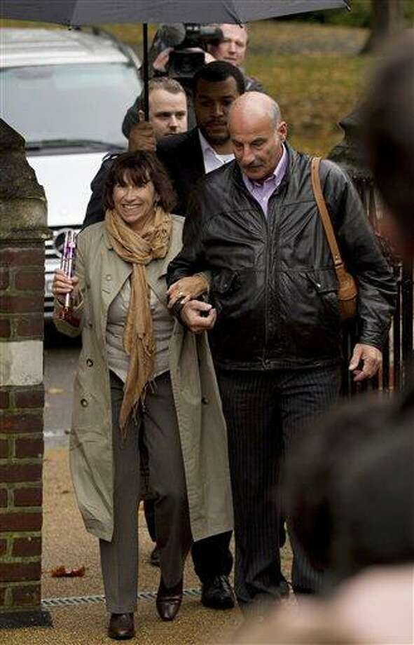 Amy Winehouse's mum Janis, left, arrives at St. Pancras Coroner's Court for a hearing into the singer's death in London, Wednesday, Oct. 26, 2011. A British coroner will hear about the final hours of Amy Winehouse's life at the inquest into the soul diva's death. The singer, who had fought drug and alcohol problems for years, was found dead in bed at her London home on July 23 at age 27. (AP Photo/Matt Dunham) Photo: AP / AP