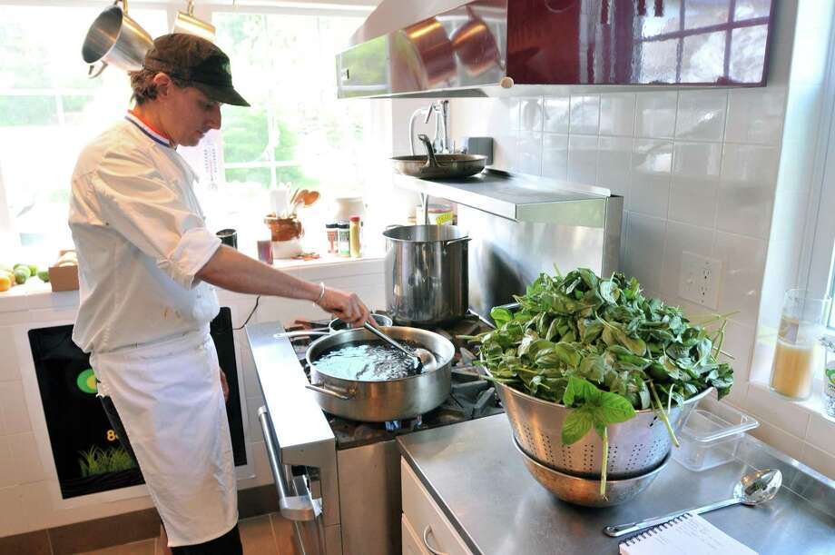 Mark Shadle prepares a Pesto sauce at Shadle Farms in Durham. (Photo by Peter Casolino/New Haven Register)