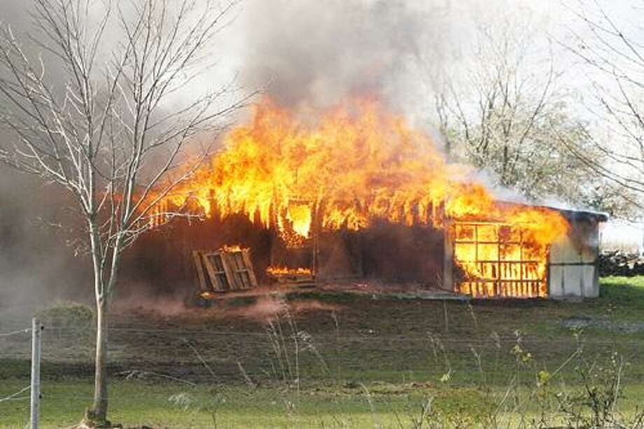 Photo by JOHN HAEGER (Twitter.com/OneidaPhoto) A barn fire on Fairview Avenue in the city of Oneida on Tuesday, Oct. 25, 2011.