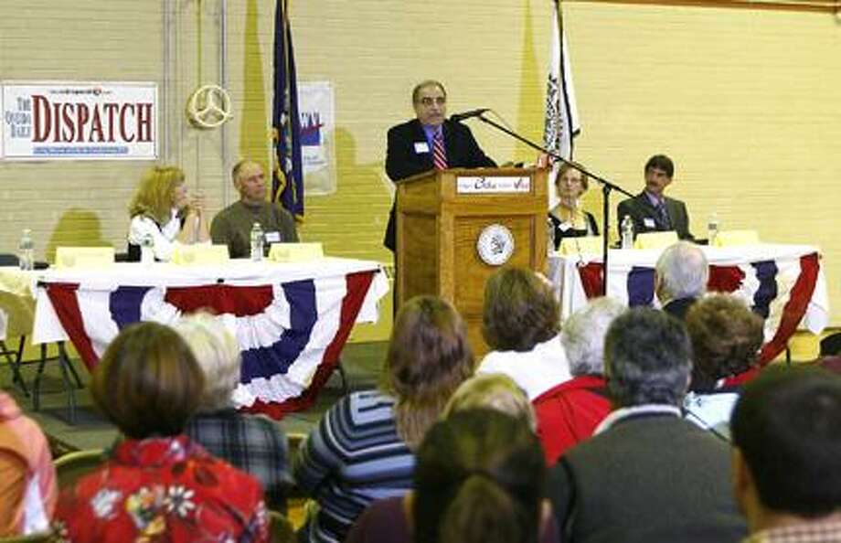 Photo by JOHN HAEGER (Twitter.com/OneidaPhoto) People look on as Oneida Common Council candidates take part in Your Choice Your Voice forum held at the Rec Center on Monday, Oct. 24, 2011.