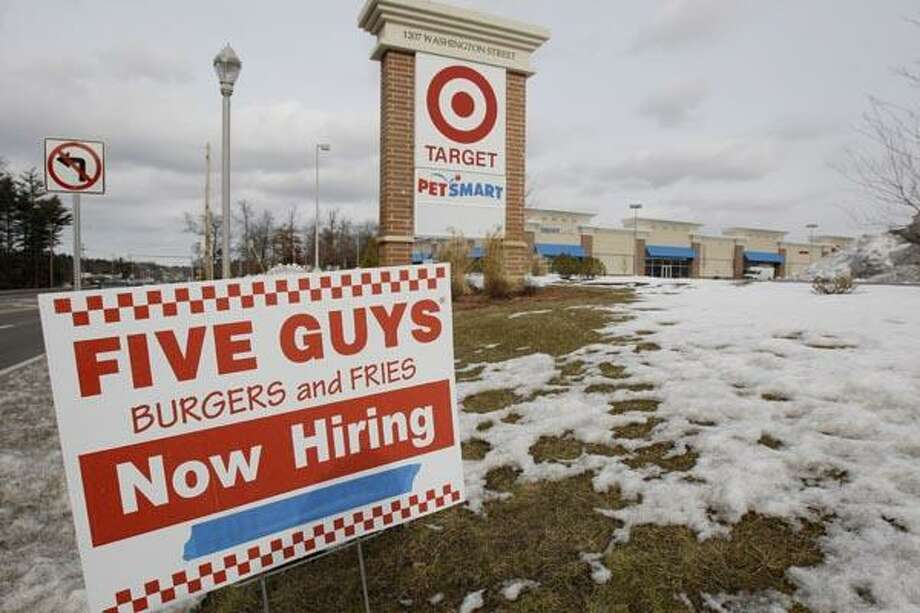 In this Friday, Jan. 7, 2011 photo a Five Guys hamburger restaurant under construction is advertising job openings. More people applied for unemployment benefits last week after retailers shed temporary holiday employees. (AP Photo/Stephan Savoia) Photo: AP / AP
