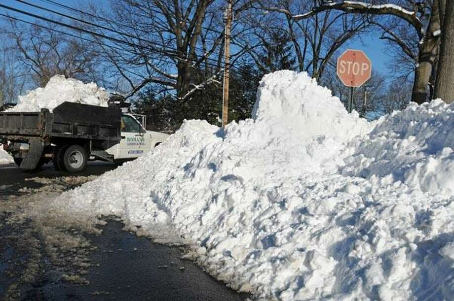 The snowbank at the corner of Giles Avenue and Sackett Point Road in North Haven has created a blind spot. (Brad Horrigan/Register)