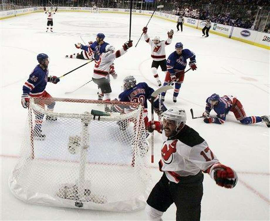 New Jersey Devils' Ilya Kovalchuk, bottom right, of Russia, reacts after scoring a goal against the New York Rangers in the first period of Game 2 of an NHL hockey Stanley Cup Eastern Conference final playoff series, Wednesday, May 16, 2012, at New York's Madison Square Garden. The Devils won 3-2. (AP Photo/Julio Cortez) Photo: AP / AP