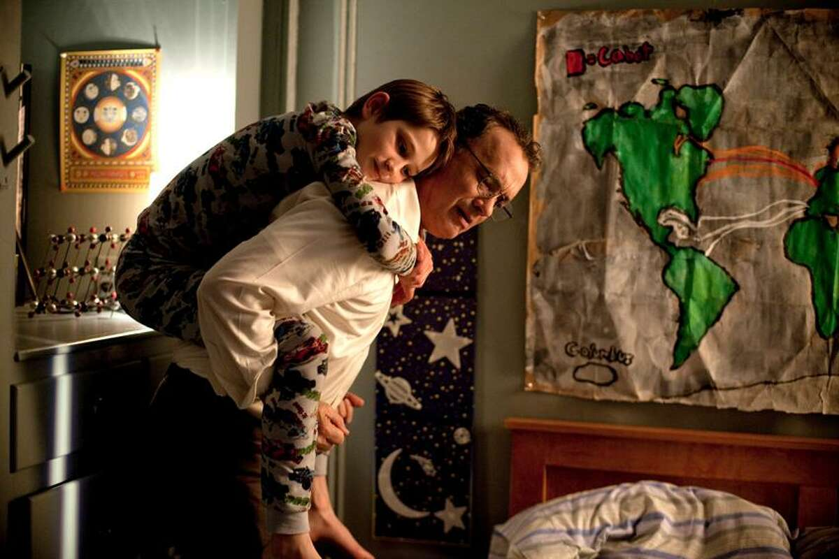 """Francois Duhamel/Warner Bros. Pictures Thomas Horn portrays Oskar Schell, and Tom Hanks is Thomas Schell in a scene from """"Extremely Loud & Incredibly Close."""""""