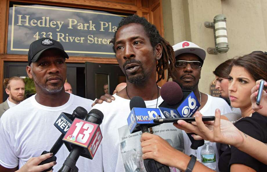 Messiah Cooper of Troy, center, tells the press and protestors how his talk with Mayor Patrick Madden went at City Hall during a protest of the shooting of Dahmeek McDonald on Wednesday, Aug. 16, 2017 in Troy, N.Y. A police officer shot the 22-year-old during a traffic stop. (Lori Van Buren / Times Union) Photo: Lori Van Buren / 20041306A