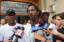 Messiah Cooper of Troy, center, tells the press and protestors how his talk with Mayor Patrick Madden went at City Hall during a protest of the shooting of Dahmeek McDonald on Wednesday, Aug. 16, 2017 in Troy, N.Y. A police officer shot the 22-year-old during a traffic stop. (Lori Van Buren / Times Union)