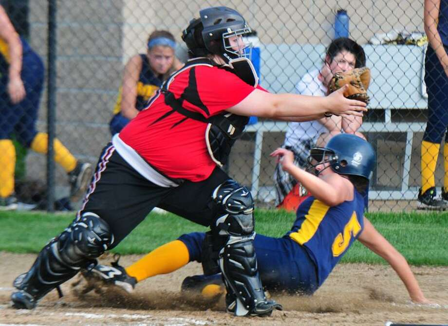 Cheshire catcher Kierstyn Bourdeau puts the tag on Mercy's Brooke Franco in the fifth inning of the game won by Cheshire 5-4.   Melanie Stengel/Register