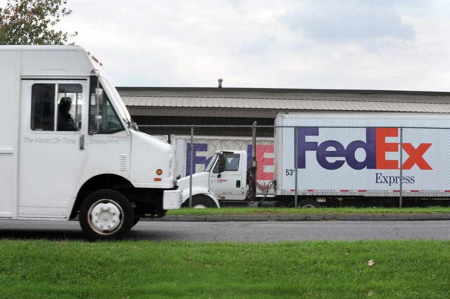 A Fedex truck departs the premises of the Fedex Service Center at 347 State Street in Hamden Monday. Fedex officials said they expect their busiest day ever to fall on Dec. 12. (Photo by VM Williams)
