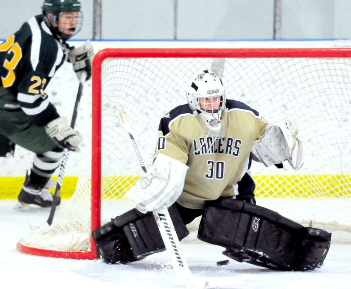 Notre Dame of Fairfield goalie Scott Kline blocks a shot from Hamden in the first period at the Milford Ice Pavilion on 1/19/2012.Photo by Arnold Gold/New Haven Register AG0435F