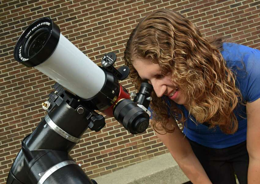 Astronomer Valerie Rapson looks through the viewfinder of one of her telescopes she will be using for an eclipse viewing party at the Dudley Observatory at MiSci Tuesday, Aug. 15, 2017 in Schenectady, N.Y. (Lori Van Buren / Times Union)