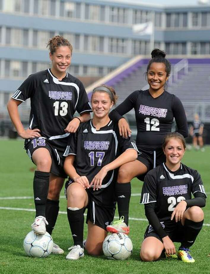University of Bridgeport soccer players Marie Biondi (13), Stephanie D'Andrea (17), Asia Pulse (12) and Gabbie Giaquinto (25) are all from the New Haven area and have helped the Purple Knights to the No. 1 ranking in the country among Division II women's soccer teams. Photo by Peter Casolino/New Haven Register.